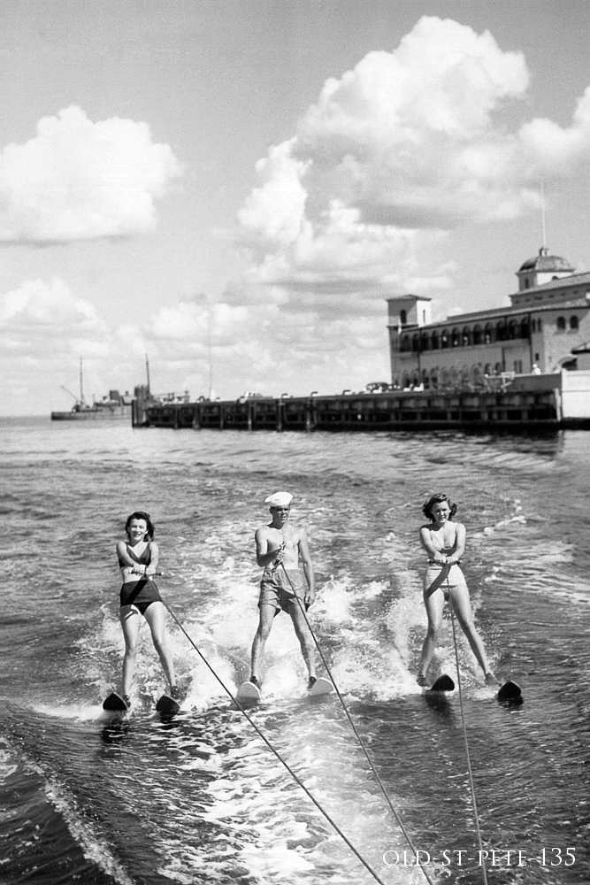 Water skiing by the pier